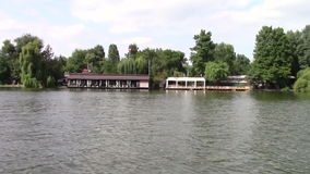 Restaurant on the lake. Restaurant seen from the boat on the lake stock video