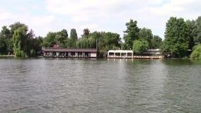 Restaurant on the lake stock video