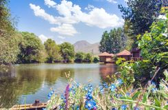Restaurant Lchak, Yeghegnadzor, Armenia. View of a pond, gazebos and mountains. royalty free stock images