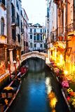 Restaurant and Gondola in Venice at night. Royalty Free Stock Photography