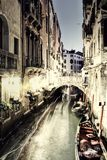Vintage Restaurant and Gondola in Venice at night. Royalty Free Stock Photography