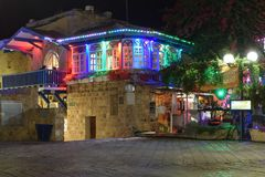 Colorfully lit restaurant at night in Old Jaffa, Israel royalty free stock image