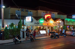 Restaurant at the main road of Laganas. Laganas, Zakynthos Island, Greece - August 25, 2015: Colorful neons on the restaurant building at the main road of royalty free stock photos