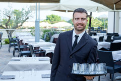 Restaurant male waiter with a tray Stock Images