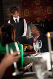 Restaurant: Man Giving Order To Waitress Royalty Free Stock Images