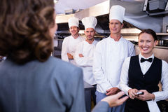 Restaurant manager briefing to his kitchen staff Stock Photography