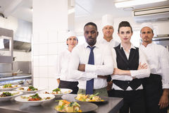 Restaurant manager with his kitchen staff Royalty Free Stock Photography
