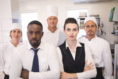 Restaurant manager with his kitchen staff Royalty Free Stock Photos