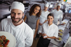 Restaurant manager with his kitchen staff Stock Images