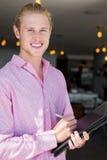Restaurant manager holding organizer. Portrait of restaurant manager holding organizer in restaurant Stock Photos