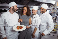 Restaurant manager interacting with his kitchen staff Royalty Free Stock Image