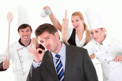 Restaurant manager with staff in the back. Funny people posing in studio Stock Images