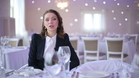 Restaurant manager tells the client about the service stock footage