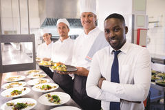 Free Restaurant Manager With His Kitchen Staff Stock Image - 92567561