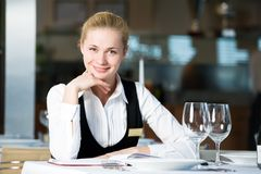 Restaurant manager woman at work. Happy beautiful restaurant manager woman administrator at work place Royalty Free Stock Photo