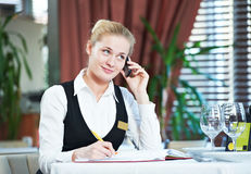 Restaurant manager woman at work. Happy beautiful restaurant manager woman administrator at work place Stock Photo