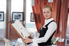 Restaurant manager woman at work place. Happy beautiful restaurant manager woman administrator at work place stock photos