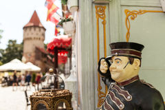 A restaurant mascot greeting customers. A cook's statue holding a sign at the entrance of a restaurant in Sibiu Royalty Free Stock Photography