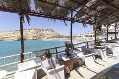 Restaurant at Matala beach in Crete island Stock Photos