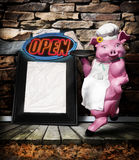 Restaurant menu. A large pink pig with a chefs hat holding a platter next to a frame for a menu.  Open sign sits on top of menu Royalty Free Stock Image