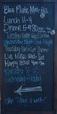 Restaurant menu. Daily menu and advertisement on chalkboard outside a restaurant Royalty Free Stock Image