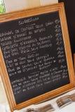 Restaurant menu board. Restaurant menu handwritten on wooden chalkboard Royalty Free Stock Images