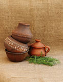 Restaurant menu. Country style. Homemade food. Still life with pottery on a burlap background Stock Image