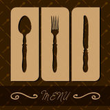 Restaurant menu with cutlery. Royalty Free Stock Photo