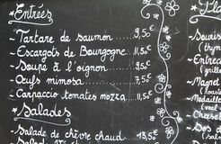 Restaurant menu in French. Outdoor bar in Paris, France Royalty Free Stock Images