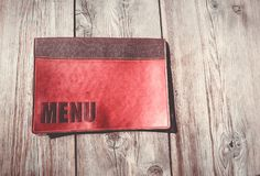 Restaurant menu on a wood table stock image