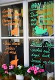 Restaurant menu written on a window in Prague Stock Photography