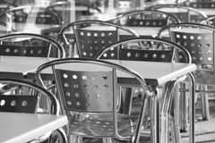Restaurant metallic chairs group outdoors in black and white Royalty Free Stock Photo