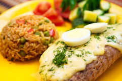 The restaurant mexican menu pork steak with egg and rice. On the yellow plate royalty free stock photos
