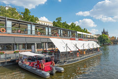 Restaurant on Moldava River - Prague - Czech Republic. PRAGUE - AUGUST 4: Along the banks of the Vltava River there are floating restaurants to eat the typical Stock Photo