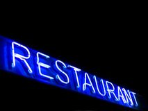 Restaurant neon sign. Neon restaurant sign at nigh royalty free stock images