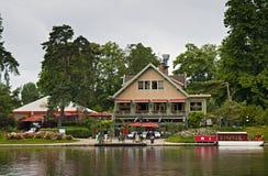 Restaurant next to peaceful lake stock image