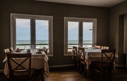 The restaurant. A restaurant with a nice maritime visible landscape across the windows Stock Photo