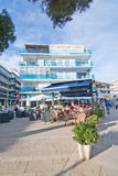 Restaurant Nogues. CAN PASTILLA, MALLORCA, SPAIN - APRIL 30, 2016: Street view with building and outdoor restaurant Nogues in Can Pastilla, Mallorca, Spain on Stock Image