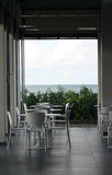 Restaurant with Ocean View. Chairs and Tables on a Ocean View Restaurant royalty free stock images