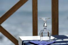 Restaurant on the oceanside. Glass on the table of a restaurant on the oceanside Stock Images