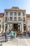 Restaurant in an old mansion on the central square of the old Brasov in Romania royalty free stock photography