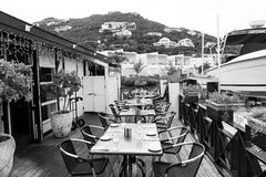 Restaurant open air in philipsburg, sint maarten. Terrace with tables, chairs and yacht in sea. Eating and dining. Outdoor. Summer vacation at Caribbean island Stock Images