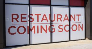 Restaurant Opening Soon. A sign lets people know that a fine dining food establishment restaurant will be opening soon in this location Stock Photos