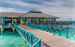 Restaurant over water in Maldives Stock Images