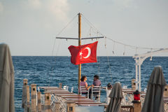 Restaurant overlooking the Aegean Sea. Tolking love people. Stock Photo
