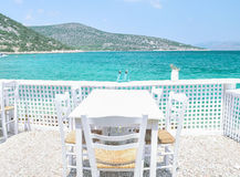The restaurant on the Greek island. Restaurant overlooking the azure sea Royalty Free Stock Photography