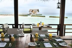 Restaurant overlooking the ocean. Served tables in the restauran Stock Photo