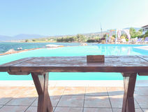 The restaurant on the Greek island. Restaurant overlooking the pool and the blue sea Stock Photo