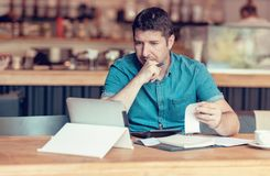 Free Restaurant Owner Checking Monthly Reports On A Tablet, Bills And Expenses Of His Small Business. Start-up Entrepreneur Concerned Stock Images - 153324534