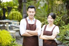Restaurant owner standing with partner Royalty Free Stock Images